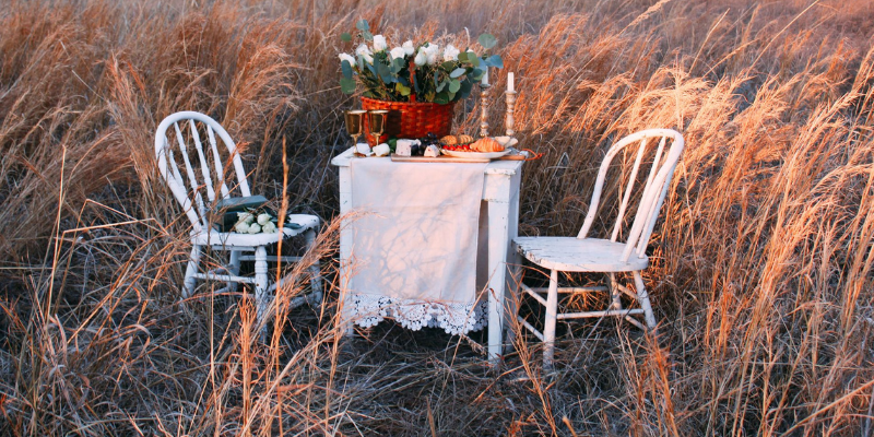 small white table set for a romantic picnic for two