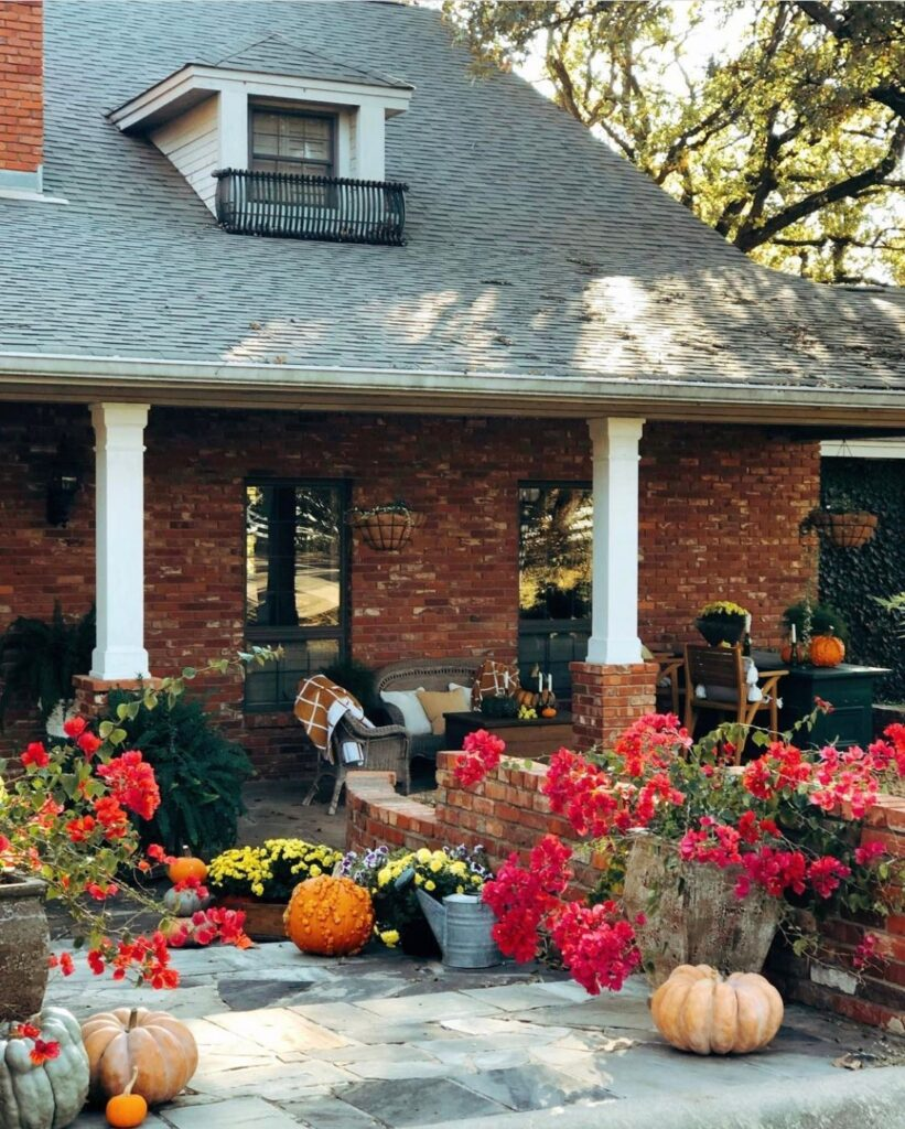 A Gardener's Dream: Large country porch with flowers and pumpkins