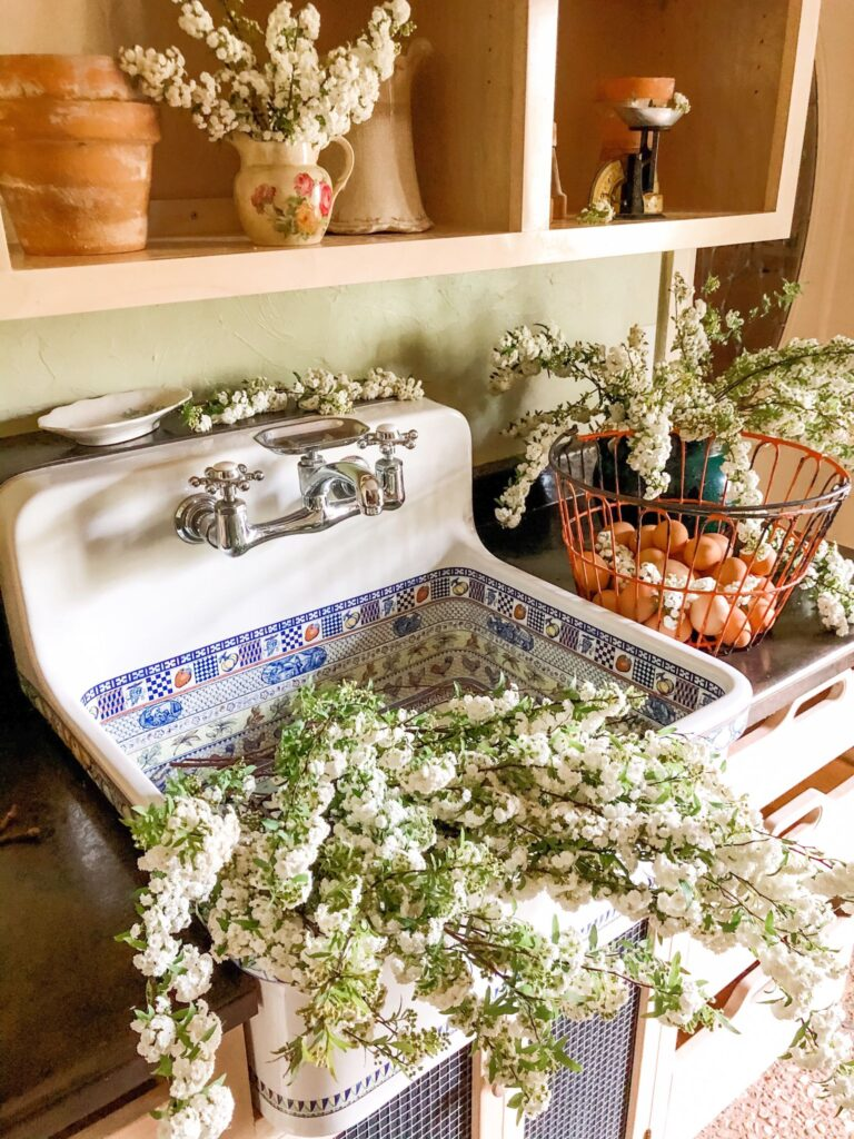 Large farmhouse sink filled with white flower