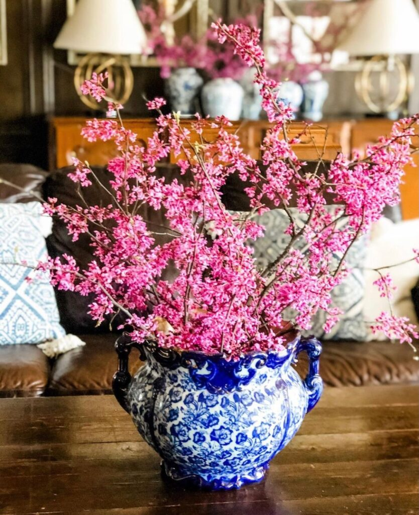 Antique blue and white haynes balt pottery with redbud stems