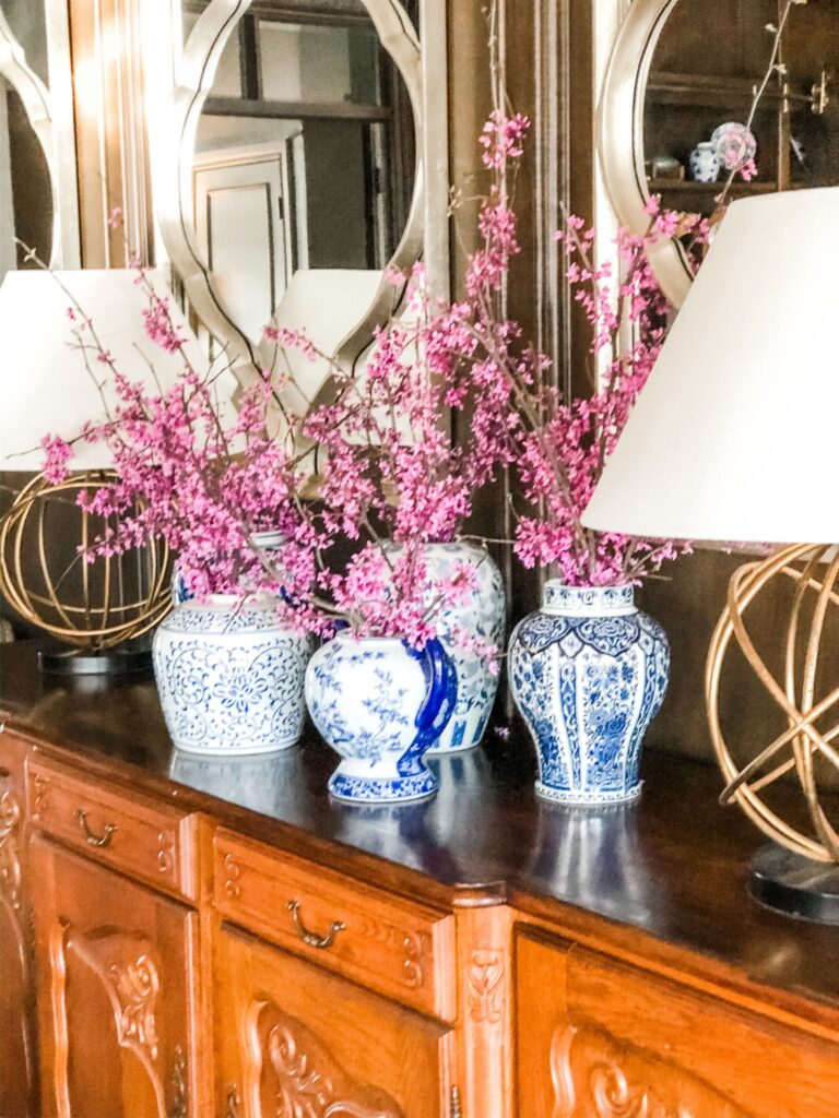 Blue and white vases filled with redbud stems