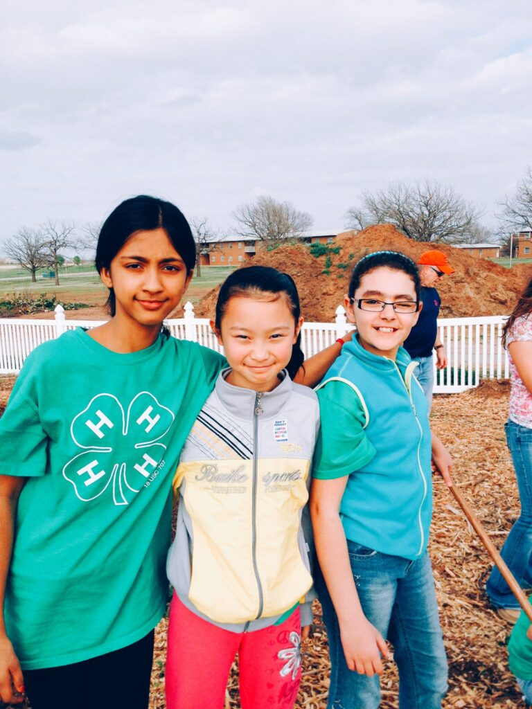 Some of our 4-Hers learning how to garden with cool season vegetables